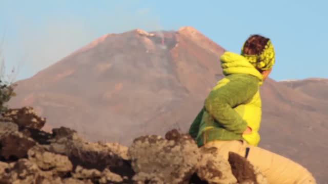 stockvideo's en b-roll-footage met smoke and lava billowed from italy's mount etna on august 28 as volcanic activity continued from the... - https