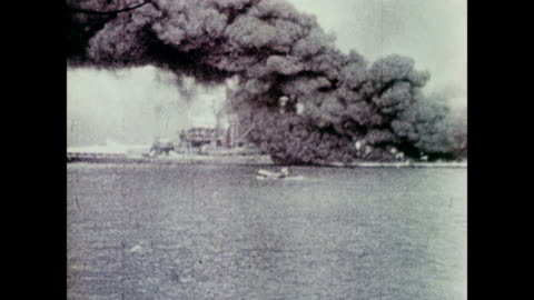 vidéos et rushes de / smoke and one ball of smoke and fire expanding as the camera man watches on a ship in the distance / huge black plume of smoke and rescue ships in... - 1941