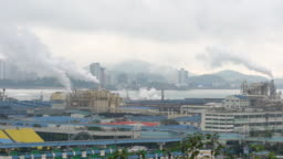 Smoke and pollution from industrial chimneys in Incheon port South Korea