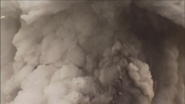 smoke and steam erupt from a volcano. - ash stock videos & royalty-free footage