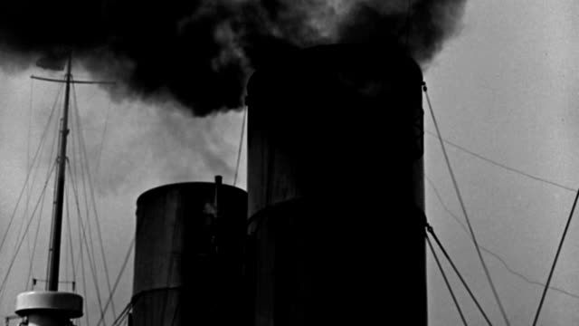 smoke and steam pour from the smokestack and whistle of a steamboat. - 1937 stock videos & royalty-free footage