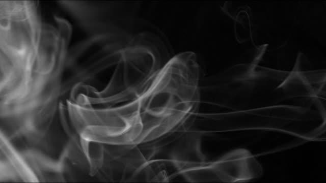 smoke background slowly swirls and whirls - espirare video stock e b–roll