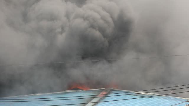 smoke bellows from a fire that broke out in warehouse of multinational company, singer bangladesh, on august 05, 2021 in dhaka, bangladesh. - global business stock videos & royalty-free footage