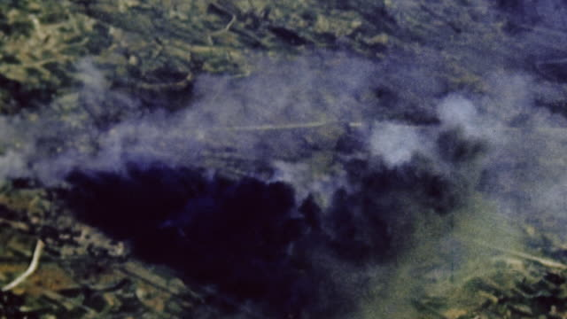 smoke billowing from bombed ground targets during wwii / okinawa japan - anno 1945 video stock e b–roll