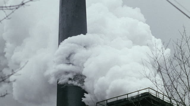 MONTAGE Smoke billowing from chimneys and smokestacks, operations at a coal mine face, and pipelines / United Kingdom