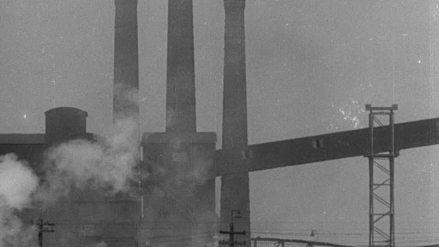montage smoke billowing from factory smokestacks - chimney stock videos & royalty-free footage