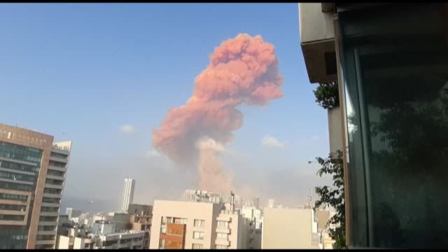 smoke billows above buildings following a large explosion in lebanon's capital beirut - smoking stock videos & royalty-free footage