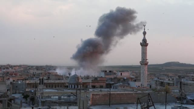 SYR: Syria: smoke billows after airstrikes on Khan Sheikhun