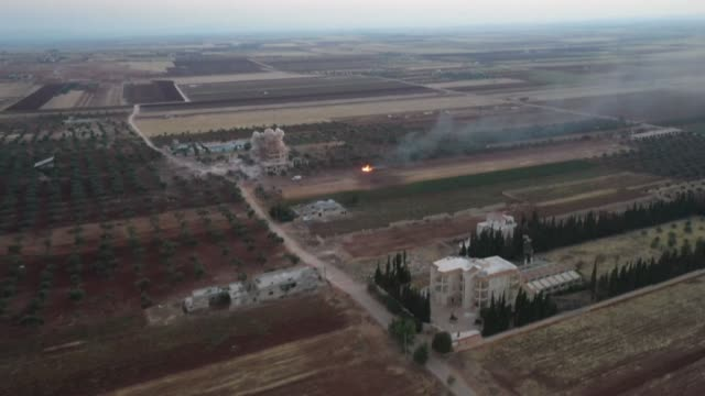 smoke billows following airstrikes and shelling on the town of binnish in syria's rebel-controlled northwestern idlib province - air raid stock videos & royalty-free footage