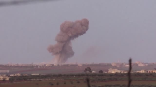 smoke billows following reported shelling by pro regime forces on the village of maaret al-naasan in the countryside of idlib province - bombning bildbanksvideor och videomaterial från bakom kulisserna