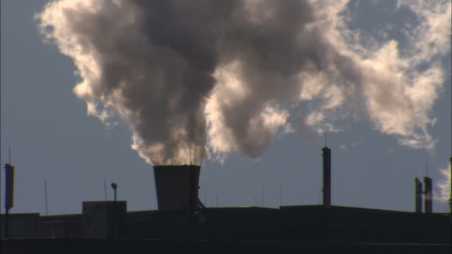 smoke billows from a smokestack. - north rhine westphalia stock videos & royalty-free footage
