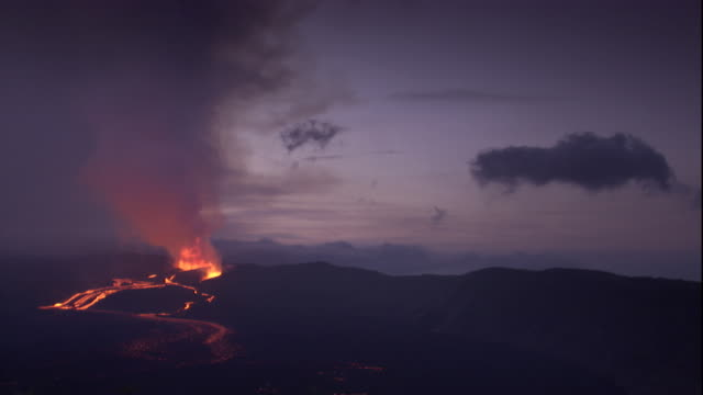 smoke billows from an erupting volcano. available in hd. - ecuador stock-videos und b-roll-filmmaterial