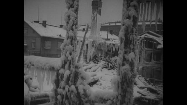 smoke billows from building with nude sculpture of a man dusted with snow and icy entrance to a building / several shots of icicles and hoarfrost on... - artiglieria video stock e b–roll
