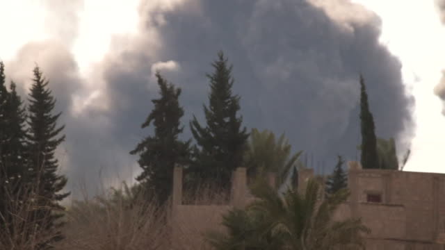 smoke billows from explosion in distance in deir ezzor syria - smoke physical structure stock videos & royalty-free footage
