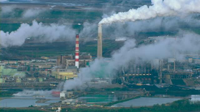 Smoke billows from smokestacks at an oil refinery near Fort McMurray, Alberta, Canada.