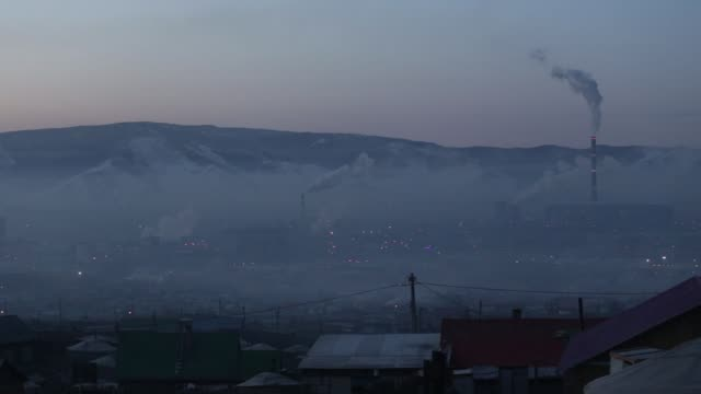 smoke billows from the chimneys of a coal-fired power station in ulaanbaatar, mongolia, on tuesday, march 14 smoke rises over a ger district in... - mongoliet bildbanksvideor och videomaterial från bakom kulisserna