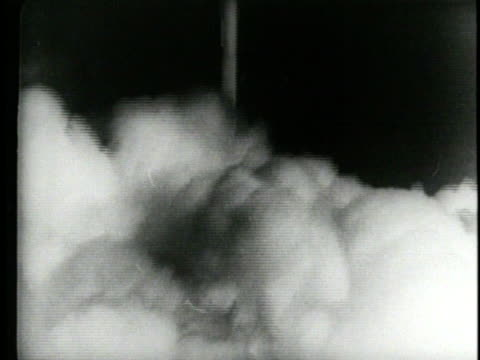 smoke billows from the launch pad after the sputnik rocket launches and scientists track its progress in a control room. - 1957 stock-videos und b-roll-filmmaterial