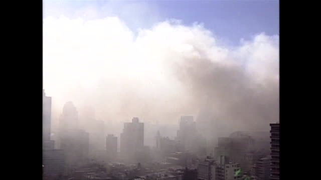 smoke billows from the rubble of ground zero on september 11th. - terrorismus stock-videos und b-roll-filmmaterial
