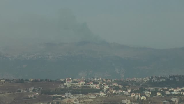 smoke billows from the town of al-mari on the lebanese side of the border with israel following clashes - image stock videos & royalty-free footage