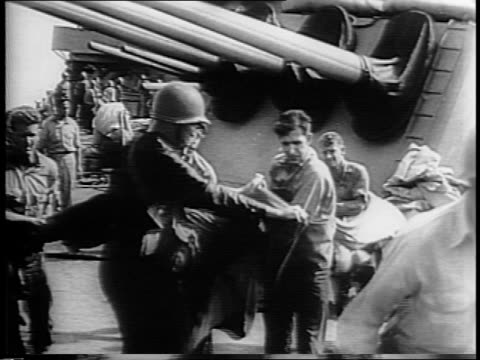 smoke billows from uss savannah after bomb hit / soldiers on deck rush to an injured man lay him on a blanket on deck cannons in background /... - blanket background stock videos & royalty-free footage