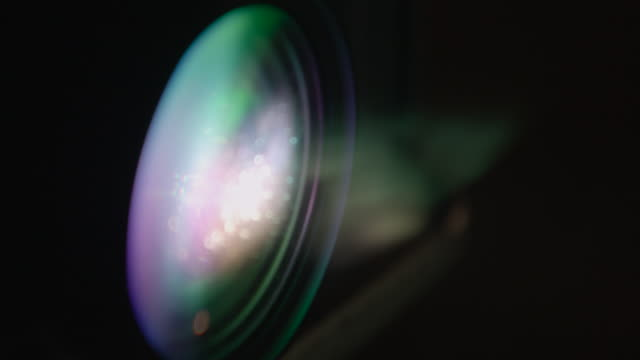 smoke blows across a projector lens - green colour stock videos & royalty-free footage
