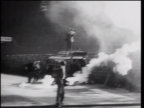 b/w 1961 smoke bomb being thrown over berlin wall / man picks it up throws it back / germany - 1961 stock videos & royalty-free footage