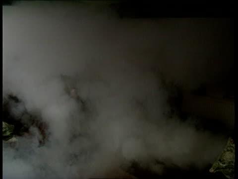 smoke burglar alarm itn reconstruction sitting room of house as burglar in through window and smoke starts to fill room cms smoke alarm emitting... - burglar stock videos & royalty-free footage