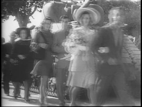 smoke cloud above rome in distance / general mark clark walks and salutes closeup clark / italian wedding party walks along the road past a tank /... - anno 1944 video stock e b–roll