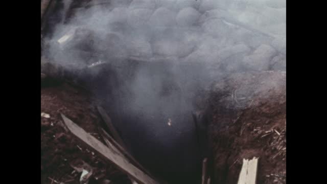 vídeos y material grabado en eventos de stock de smoke comes from bunkers that caught fire when north vietnamese commandos threw in grenades and explosive michael fitzmaurice was awarded the medal... - campo de batalla
