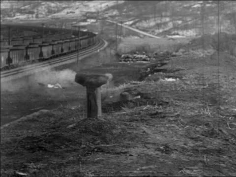 vidéos et rushes de b/w 1935 smoke coming from chimney of coke oven under hill at coal mines / pennsylvania / newsreel - 1935