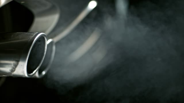 slo mo smoke coming from the car exhaust pipes - super slow motion stock videos & royalty-free footage