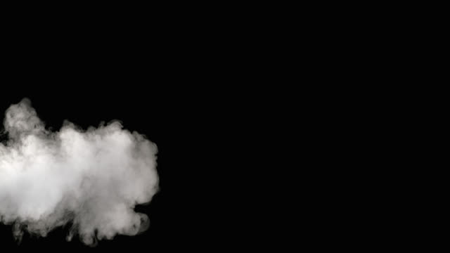 slo mo of smoke coming from the left side - black background stock videos & royalty-free footage