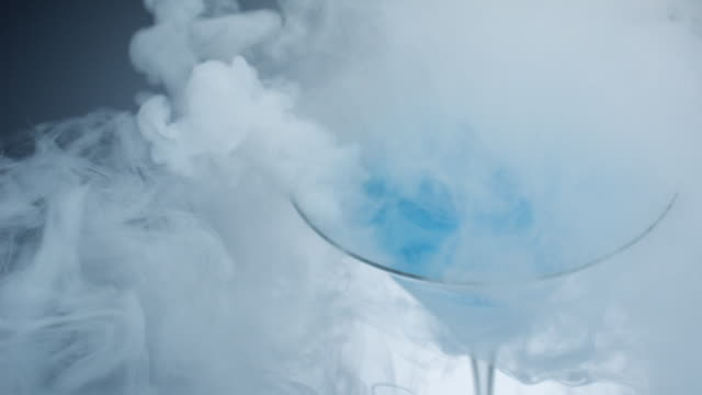 smoke coming out from dry ice and liquid in cocktail glass - dry ice stock videos & royalty-free footage