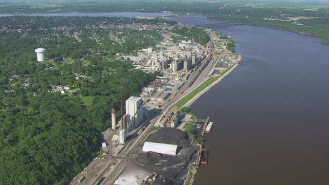 WS AERIAL POV Smoke coming out from funnel at Biodiesel plant / Keokuk, Iowa, United States