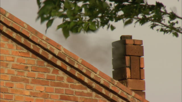 cu la smoke coming out of chimney of brick house, longbaoshan village, hebei, china - brick house stock videos and b-roll footage