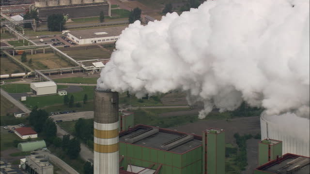 aerial smoke coming out of power station's chimneys, schkopau, saxony, germany - saxony stock videos & royalty-free footage