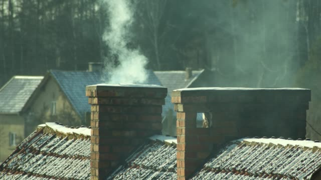 smoke coming out of the chimneys in winter - chimney stock videos & royalty-free footage