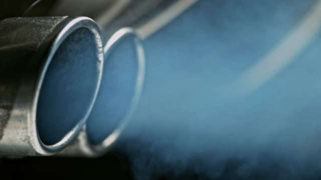 smoke coming out of the double exhaust pipes of the car - car stock videos & royalty-free footage