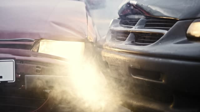 smoke coming out of the two cars crashed in an accident - incidente automobilistico video stock e b–roll
