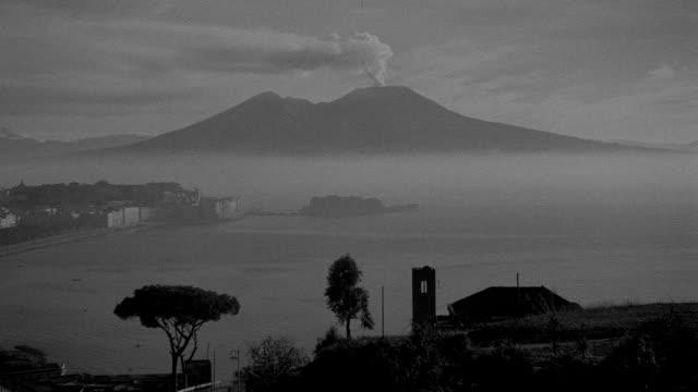 smoke drifts from mount vesuvius near naples, italy. - baia video stock e b–roll
