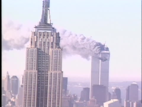 smoke drifts off of the twin towers in new york city on 9-11. - destruction stock videos & royalty-free footage