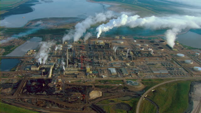Smoke drifts over the Athabasca oil sands from an oil refinery in Alberta, Canada.