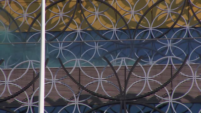 smoke emitted from the roof of the library of birmingham as the city launches its clean air zones - smoke physical structure stock videos & royalty-free footage