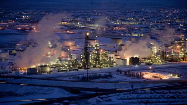 ws t/l smoke emitting factory and illuminated cityscape at night / salt lake city, utah, usa - utah stock videos & royalty-free footage