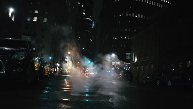 smoke emitting from street in illuminated city - low angle view stock videos & royalty-free footage