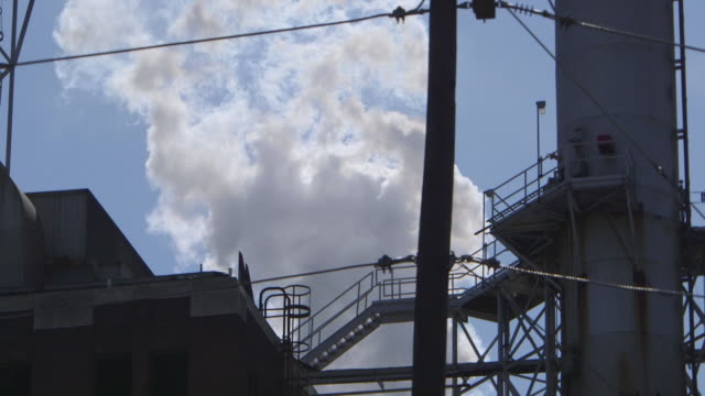smoke erupts from energy plant smokestack - toxic waste stock videos & royalty-free footage
