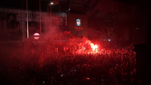 smoke fills the air as a crowd gathers around fire and fireworks set off while football fans at anfield stadium celebrate liverpool fc winning the... - fan enthusiast stock videos & royalty-free footage