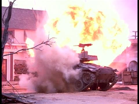 smoke fills the air near a tank after an explosion. - zweiter weltkrieg stock-videos und b-roll-filmmaterial
