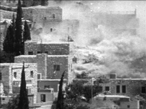 b/w 1967 smoke flames rising from buildings after bombing in six day war / jerusalem / newsreel - sechstagekrieg stock-videos und b-roll-filmmaterial