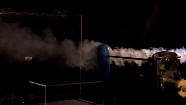 smoke flows past an apparatus mounted to a clamp. - clamp stock videos & royalty-free footage